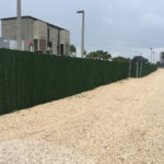 TALL CHAIN LINK FENCE WITH SLATS